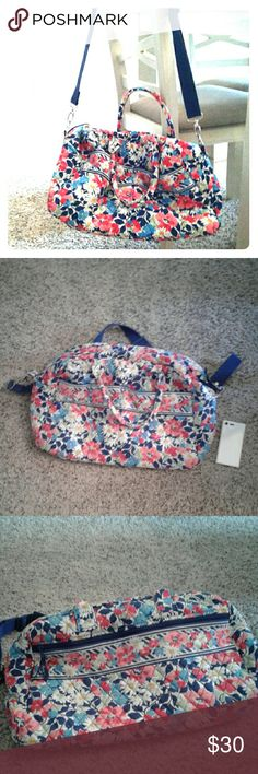 Vera Bradley Weekender Vera Bradley weekender bag, was well loved so the shoulder strap is coming apart from the bag, but can be restitched easily to make new again! No stains or tears other than mentioned. Vera Bradley Bags Totes
