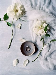 Flatlay Inspiration · via Custom Scene · detail ring shoot with pale blue accents and white garden roses