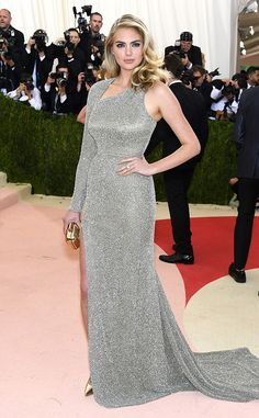 2016 Met Gala: Kate Upton sparkles in a silver one shoulder cutout Topshop dress with a train. Kate is gorgeous! I adore this dress! It fits her like a glove!
