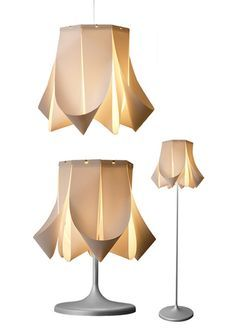 This stylish lamp was made with vertical blinds slats.