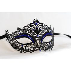 Black masquerade mask, Laser cut metal masqurade mask with royal blue... ($21) ❤ liked on Polyvore featuring costumes, masks, accessories, black costume, black halloween costumes, prom costumes, party costumes and masquerade costumes
