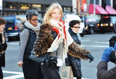 Streetstyle photographer Candice Lake in front of the lens #fur | Photography by Tommy Ton for style.com #streetstyle