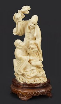 A Chinese Carved Ivory Figural Group.