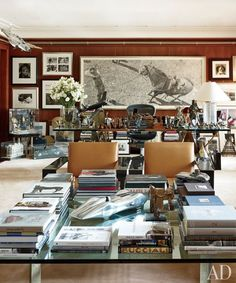 Lauren's office at the company's Madison Avenue headquarters is filled with art, books, and sundry objects that inspire him, including a 1950s model plane suspended from the ceiling. A large graphite drawing by Woodrow Blagg is displayed behind the designer's Highbridge glass-top desk, which is by Ralph Lauren Home. The City Modern cocktail table and leather-clad RL-CF1 Carbon Fiber lounge chairs are Ralph Lauren Home designs as well.