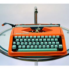 If I was inclined to use a typewriter in 2012 I would surely go for an orange model with aqua keys. I would love a computer keyboard in this color scheme.