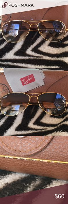 Ray Ban Aviator Sunglasses In new condition worn maybe once for an hour decided I did not care for them on my face there for my loss is your gain. It comes with the case the original lens cleaner and of course the sunglasses.  These are brand new but I have miss placed the tags. Ray-Ban Accessories Sunglasses