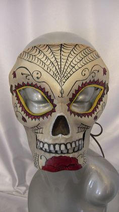 Who doesn't like a bit of the Day of the Dead? It's fun to see someone design a festive yet unsettling mask like this one.