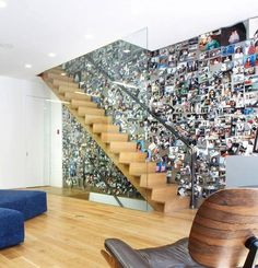 small photographs for wall decoration and glass staircase railing