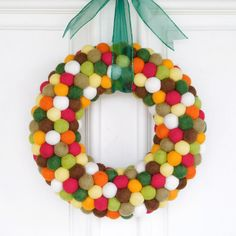Lighten up your fall doorway with this wreath of fun hand-felted wool. The playful felt balls are dyed in a beautiful autumn rainbow for quirky texture and rich color.