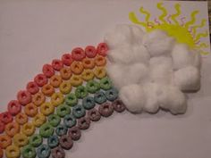 Rainbow craft! Supplies: fruit cereal, glue, paper, cotton balls and markers.