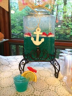 Nautical Theme Drink, notice the cup with the accented fruit & Sweetish Fish! CUTE!