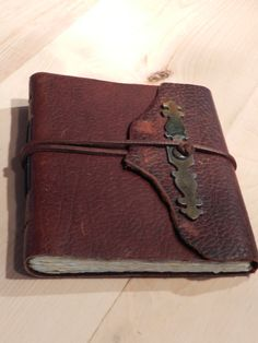 "Handmade Leather Bound Reclaimed Hardware Travel Diary Garden Journal Photo Album Guest Book 6 1/2"" x 7"". $30.00, via Etsy."