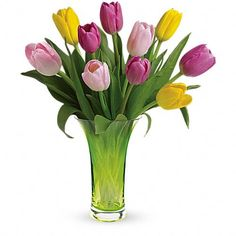 It's tulip time! This bright bouquet features sweet shades of pink and yellow tulips beautifully arranged in a Simply Sublime glass vase.