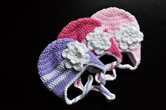 Striped Crochet Flowered Earflap Hat pattern by Classy Crochet ~ free pdf pattern at Ravelry ~ Detailed pattern instructions for:  0-3 Months; 3-9 Months; 9-12 Months; 1-3 Years  One Lion Brand Pound of Love will make many hats. I can usually get 2 or 3 out of a Caron Simply Soft or Red Heart. H/5.0mm +I/5.5mm hook,  Tape measure for checking hat size