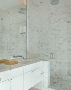 could build in a bench seat where vanity wall meets shower- in corner