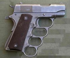 """BRASS KNUCKLE SHOOTER  new meaning to """"pistol whipped"""""""