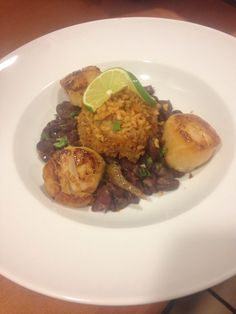 Pan-seared scallops served with fiesta beans and Mexican rice