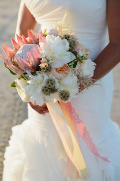 King protea, peony, rose bridal bouquet at Corolla Beach Wedding    Heart of Harlow Outer Banks wedding coordinator Photogrpahy by Neil GT Photography