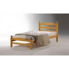 £89.99 - Beautifully Designed the Moderna Wooden Bed Frame, a Simple ranch design made with a Durable rubberwood hardwood frame and features a simple design with matching ball tops on all corners. This bed frame comes in a maple finish. The external finish of the bedstead gives off a warm and homely glow.