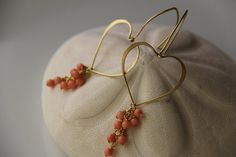 Gold tone Brass earrings with bamboo coral by Keepandcherish, $29.99