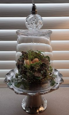 awesome cloche from repurposed objects~look at the salt shaker on top!