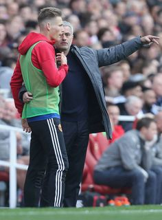 Manager Jose Mourinho of Manchester United speaks to substitute Scott McTominay during the Premier League match between Manchester United and Arsenal...