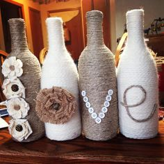'Love' wine bottle set. Twine and yarn wrapped wine bottles for a great rustic set. Wine bottle craft. DIY. To order a set email cork.crazy@hotmail.com. I ship to the US only and accept paypal for payment. Thanks y'all.