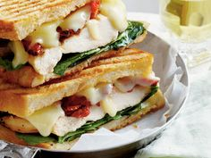 Smoky Chicken Panini with Basil Mayo | Smoky Gouda cheese, sun-dried tomatoes, and baby spinach join grilled chicken breasts in this panini that's slathered with fresh Basil Mayo.