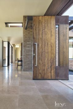 Honest, stripped-down materials—concrete, salvaged wood, rammed earth—are the new heroes of high-end residential architecture.