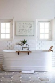 Bath tub goals | bathroom bliss| small pane windows | subway tiles | Sourced via Miss Moss #wishtankworthy ♥