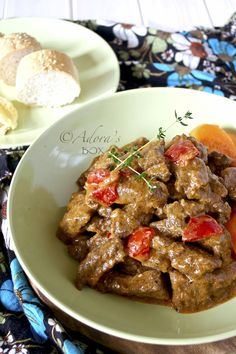 BEEF GOULASH: 1 kg. braising steak, cut into cubes flour seasoned with salt and pepper for dredging 2 tbsps. olive oil 2 tbsps. butter or butter substitute 3 cloves of garlic, crushed 2 medium onions, sliced 1 tbsp. paprika 2 tbsps. tomato paste 2 c. beef stock (boiling hot) 1/4 c. sherry (optional) 1 sprig of fresh thyme 1/2 of a small red sweet pepper, sliced 1/4 c. crème fraîche or sour cream