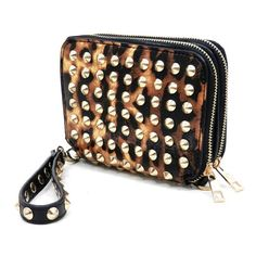 Absolutely fabulous handbag! Fits iPhone 4/4S, iPhone 5 and iTouch 4/5. Perfect gift for any occasion!Designer Inspired handbagFaux leatherZip round closureGold-tone hardwareDetachable handle