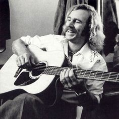This is the way I'll always remember Jimmy Buffett. Young. 1,000 watt smile. Hair and a moustache. Still love him after all these years.