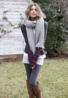 Maroon leather jacket, gray leggings, brown boots, layered sweaters, giant scarf.