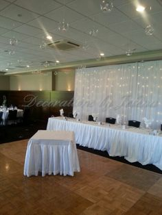Fairy light backdrop and hanging candles at wedding reception