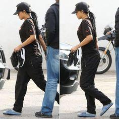 Rihanna wearing Pigalle snapback cap, Puma Savior/Villain black t-shirt, Puma Carson running shoes, O Mighty OG Levi's denim slides