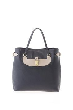A key style of the Colorblock Manhattan family, the Mercer is a classic and elegant midsized bag. Features flat leather handles, boxy tote shape, and unique contrast buckle details.100% Lamb Leather.15