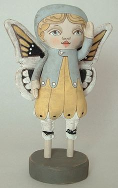 Pretty doll for a little girl's nursery- A little creepy but cool enough to work!