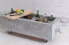 There's no reason to go out and buy new flower pots -- or a beer cooler for that matter. HomeMade Modern's done it again, this time showing us how to make a DIY concrete planter that has a built-in spigot for drainage.