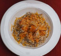 This butternut squash recipeincorporates barley, a healthy whole grain,with cheddar, cinnamon, and nutmeg for a warm and tasty vegetarian dish. #butternutsquash #recipes