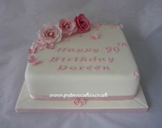 Square 90th birthday cake decorated with roses, blossoms and butterflies.  Simple to do but very pretty.
