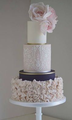 Elegant three tier blush, navy and white wedding cake with gold wrap detail; Featured Cake: Cotton & Crumbs.