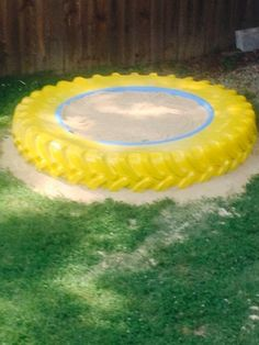 Sandbox hubby made for our grandson with an old tractor tire!