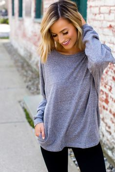 Casual & SO cute! Grey long sleeve top with side pocket detail. Fits true to size, the model is shown wearing a small. Made of soft cotton fabric. Dottie Couture Boutique, Grey Long Sleeve Tops, Pocket Detail, Cotton Fabric, Final Sale, Sweatshirts, Casual, Model, Sweaters