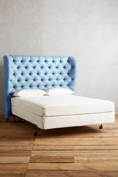 Linen Tufted Wingback Headboard - anthropologie.com