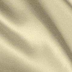 Stretch Charmeuse Satin Ivory from @fabricdotcom  Get a high style look in this sophisticated stretch charmeuse satin fabric! This gorgeous fabric has a lustrous sheen that beautifully reflects the light, a soft hand and a wonderful drape. It is perfect for creating special occasion apparel, blouses, dresses, lingerie and skirts.   Fabric has 10% stretch across the grain for added comfort and ease.