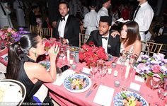 Hello!? While Selena Gomez and The Weeknd certainly seemed lost in one another, they also appeared to lose the rest of the table as they were photographed among a host of empty chairs at Monday night's Met Gala in NYC
