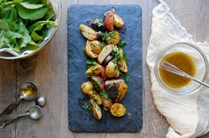 palate/palette/plate: grilled baby potatoes with mint, arugula and lemon-pepper vinaigrette Seasoned Potato Wedges, Baby Potatoes, Tasty, Yummy Food, Lemon Pepper, Caramelized Onions, Arugula, Side Dish Recipes, Snack Recipes