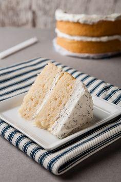 Lemon Velvet Cake with a Lemon Poppyseed Buttercream: a tart and sweet cake by ibakeheshoots.com
