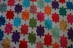 This is random but I saw a similar quilt at an antique store.  Turtle quilt..cool.